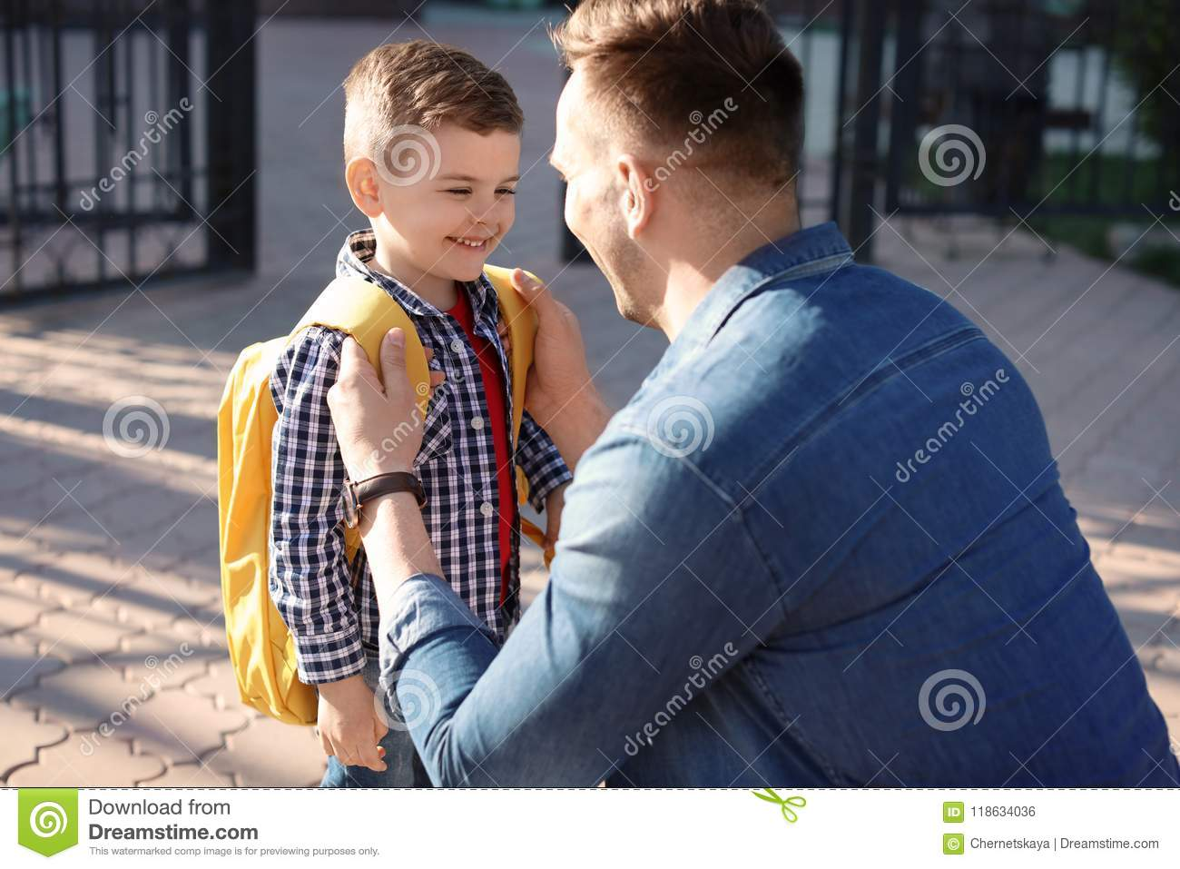 Young man saying goodbye to his little child