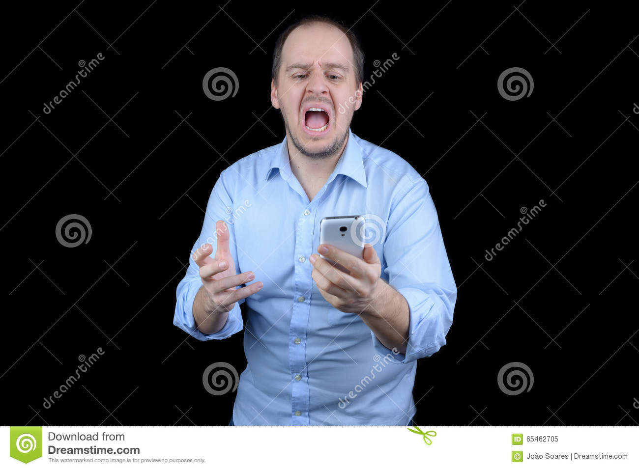 Young man screaming at mobile phone
