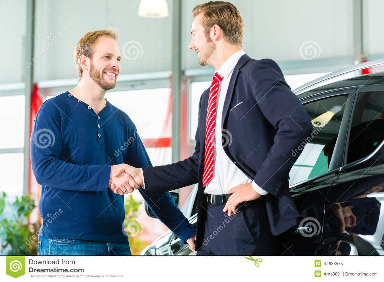 young man and seller with auto in car dealership stock image image of salesman hand 44838575. Black Bedroom Furniture Sets. Home Design Ideas
