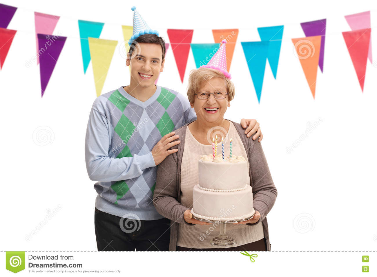 Young man and senior with party hats and birthday cake