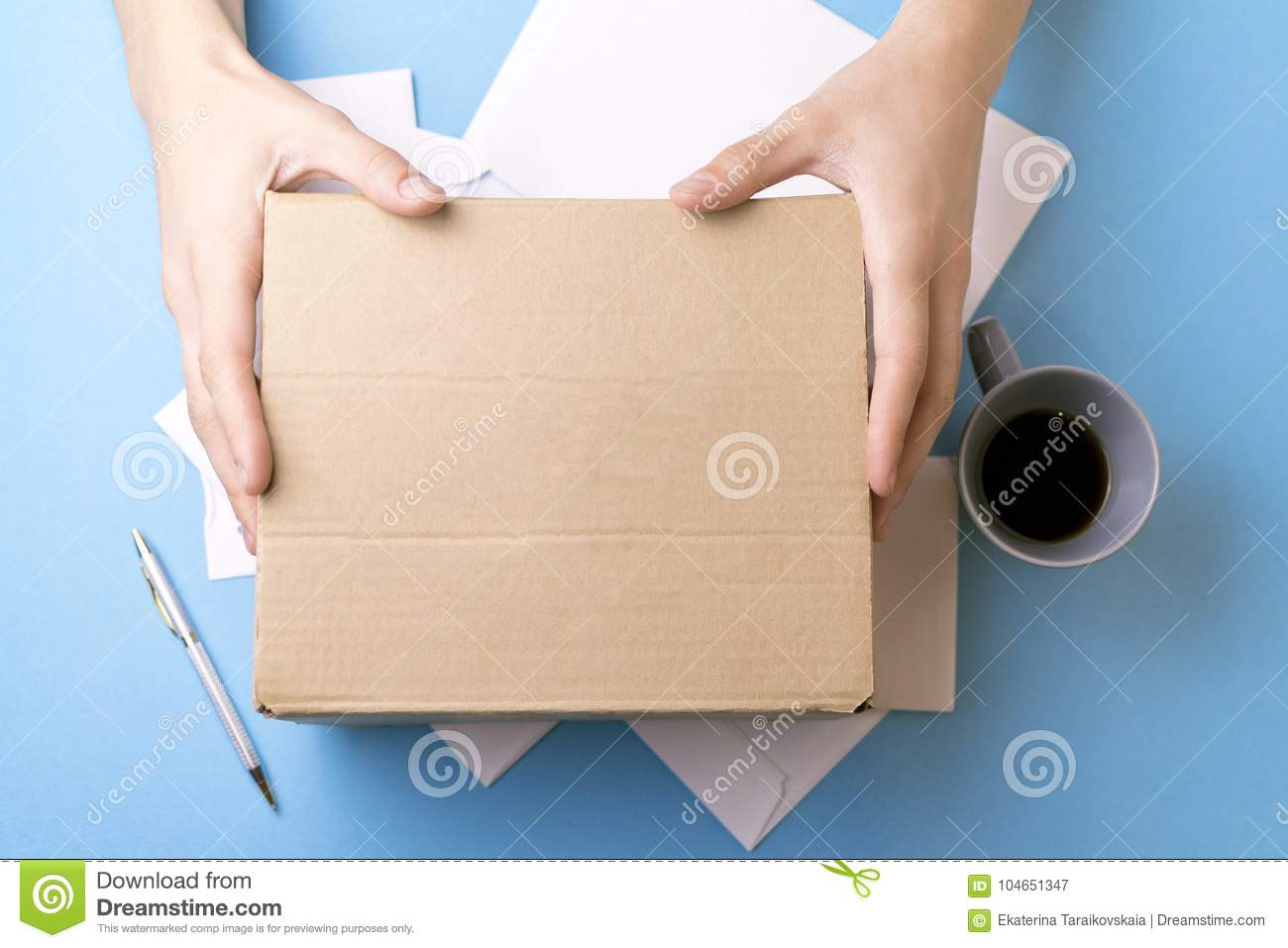 The young man signs the letters and parcels. The concept of service delivery, the post office.