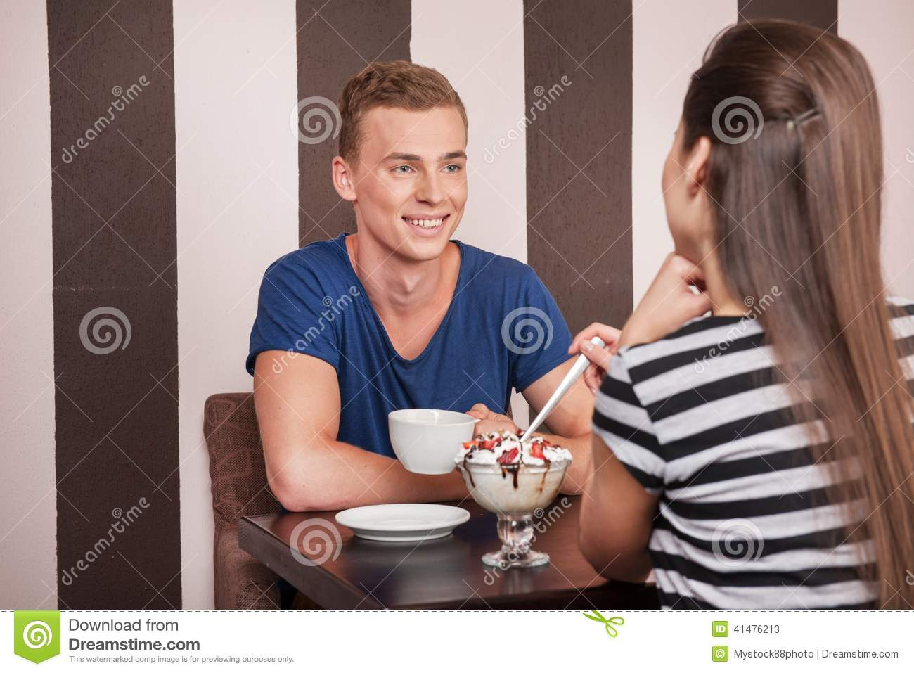 Young man sitting with beautiful girl.