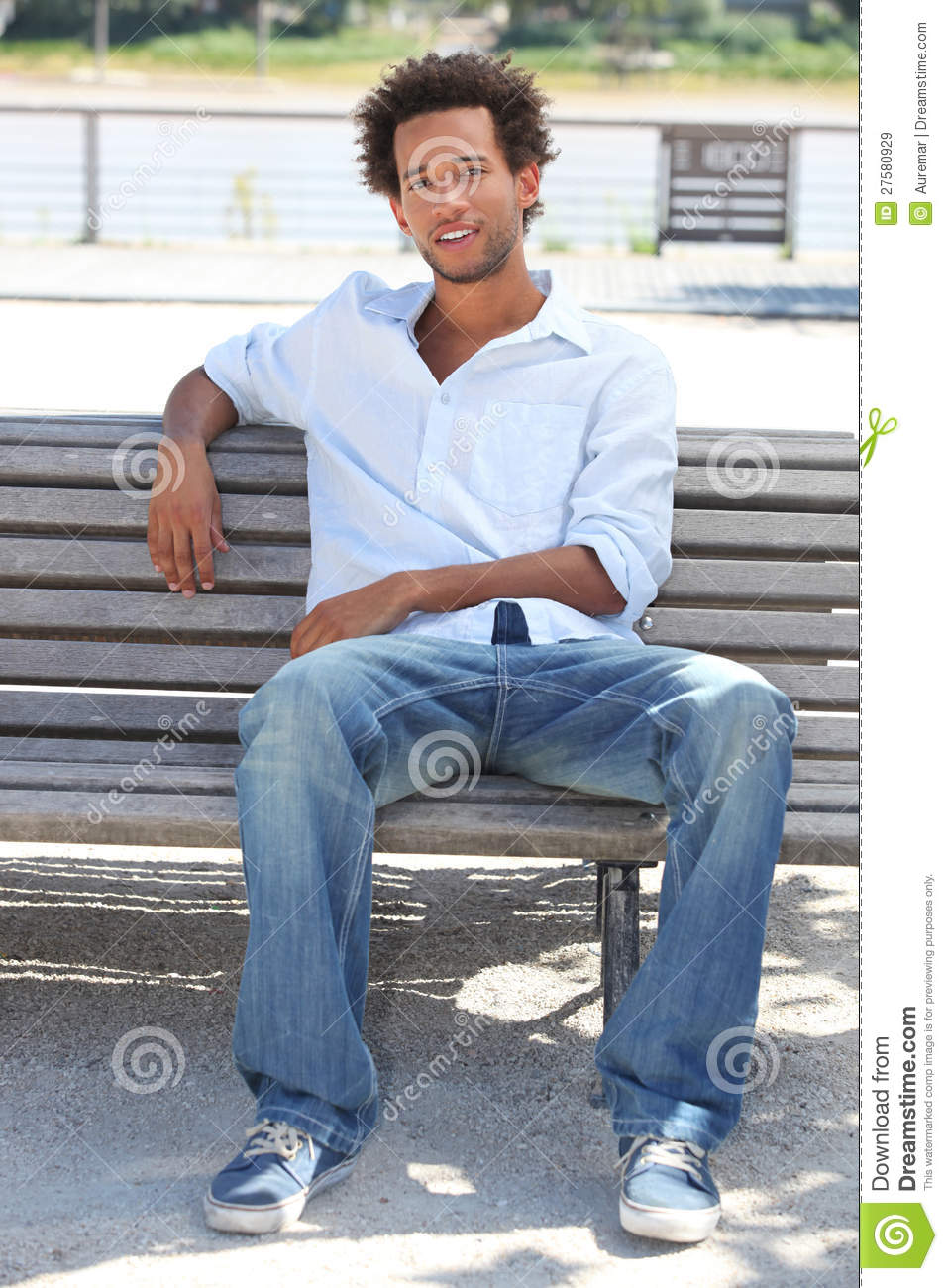 Young Man Sitting On Bench Royalty Free Stock Images ...