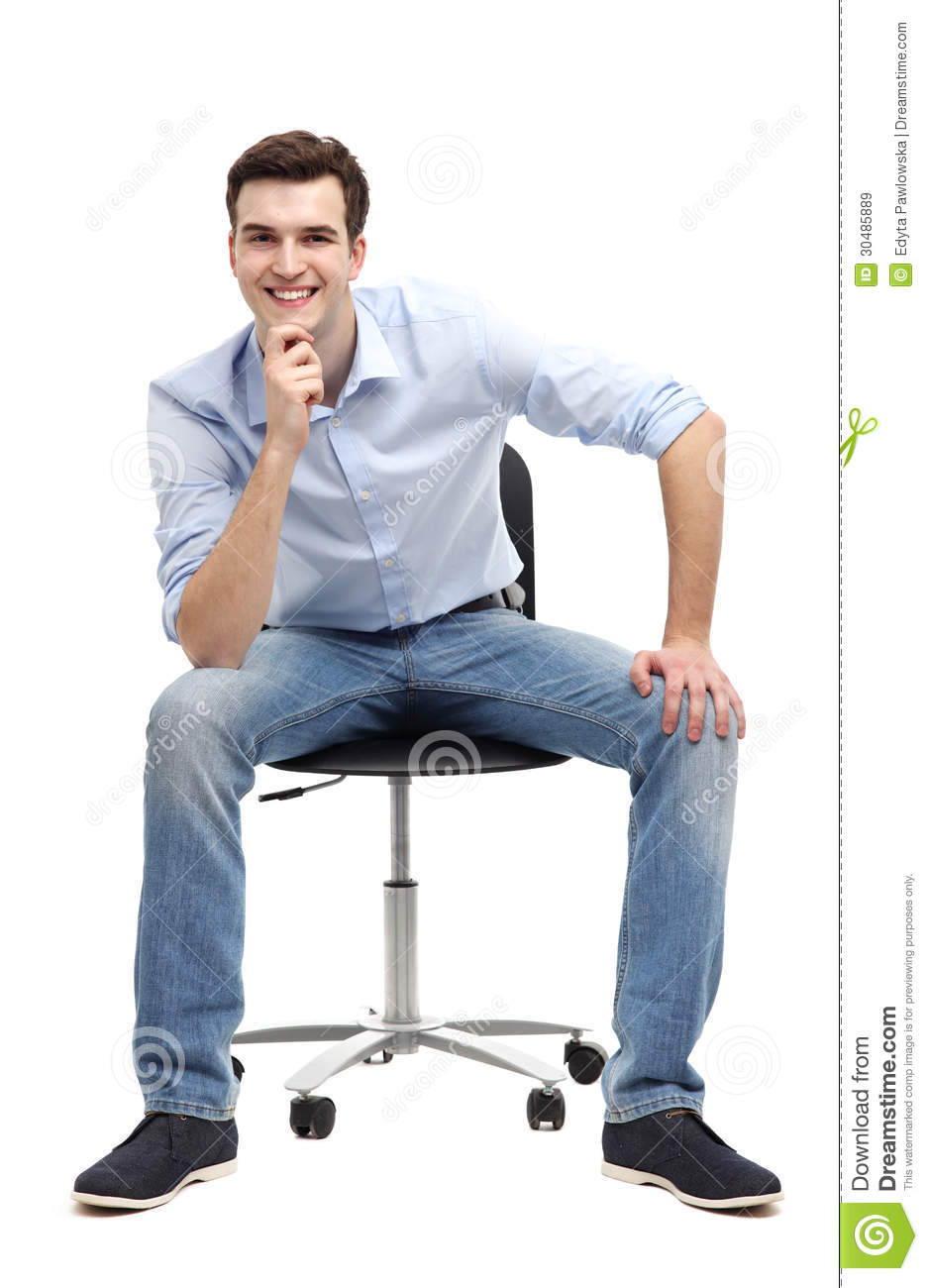 Young man sitting in chair royalty free stock images for Sitting chairs