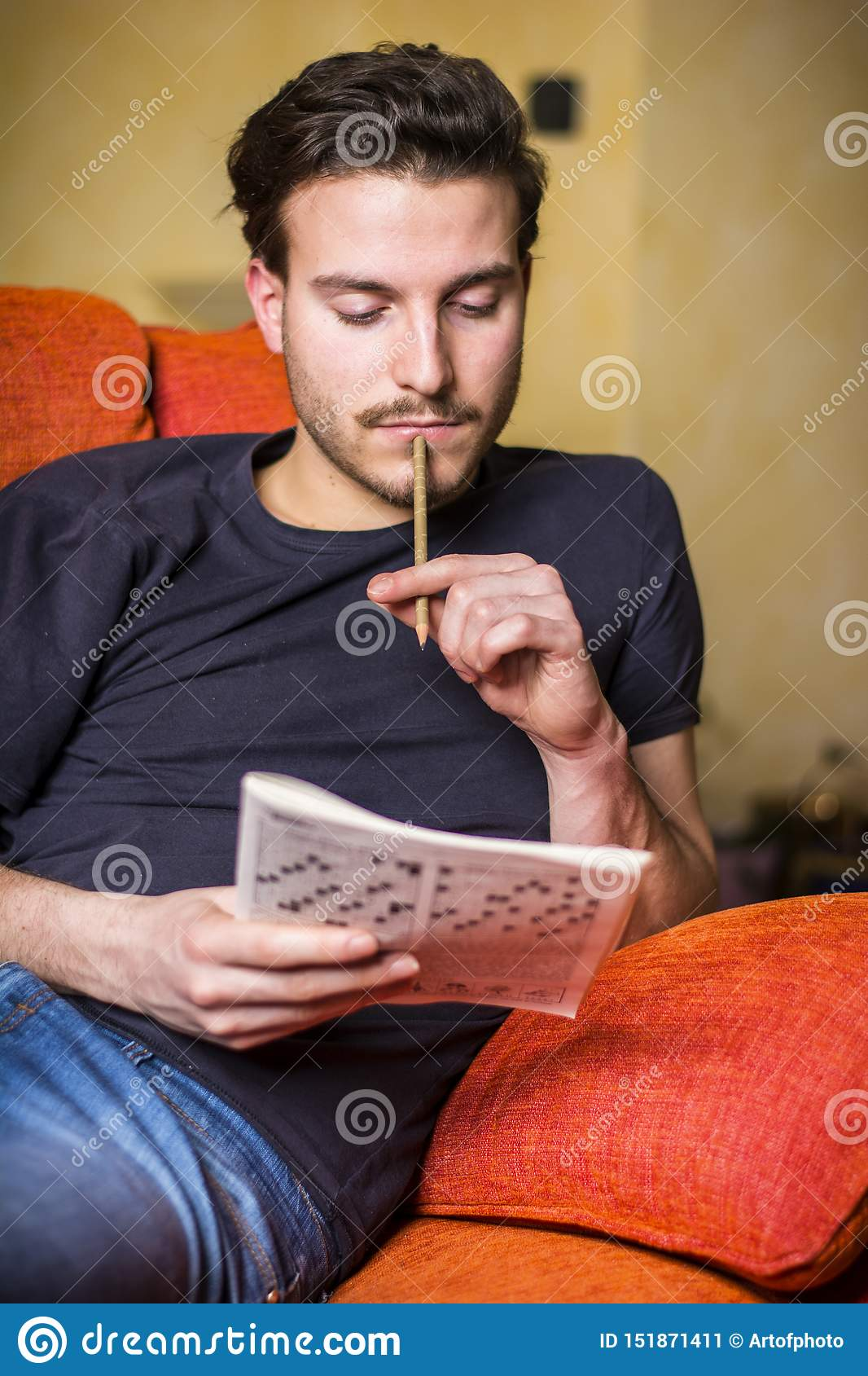 Young Man Sitting Doing A Crossword Puzzle Stock Image Image Of Recreation Activity 151871411