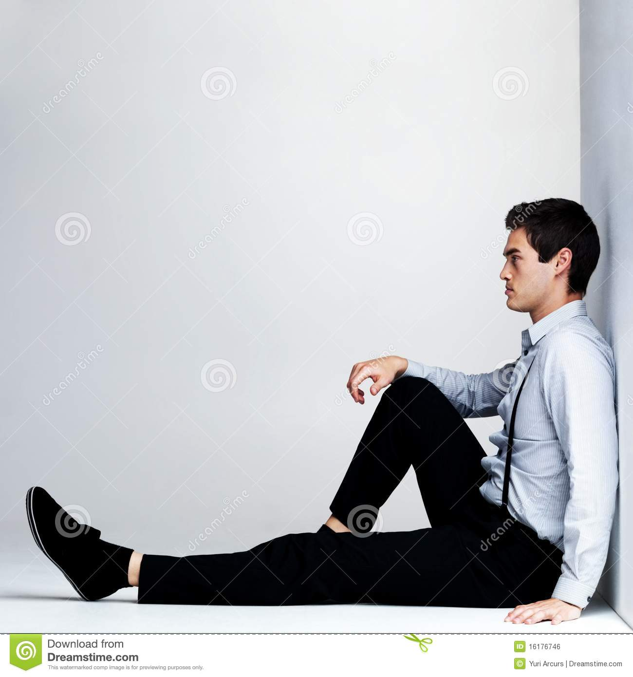 Royalty free stock image young man sitting on the floor for On the floor on the floor