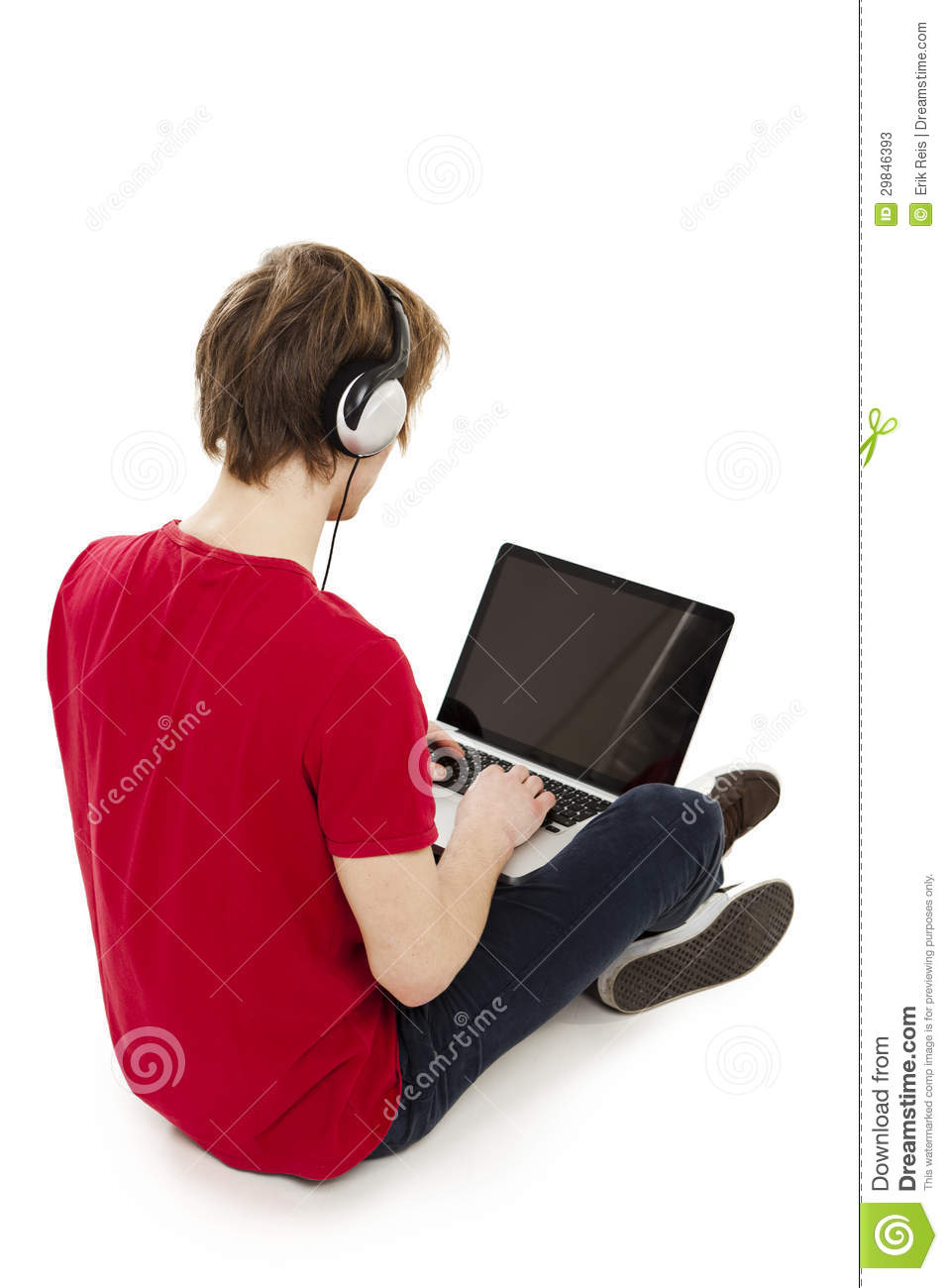Young man sitting in the floor playing computer games