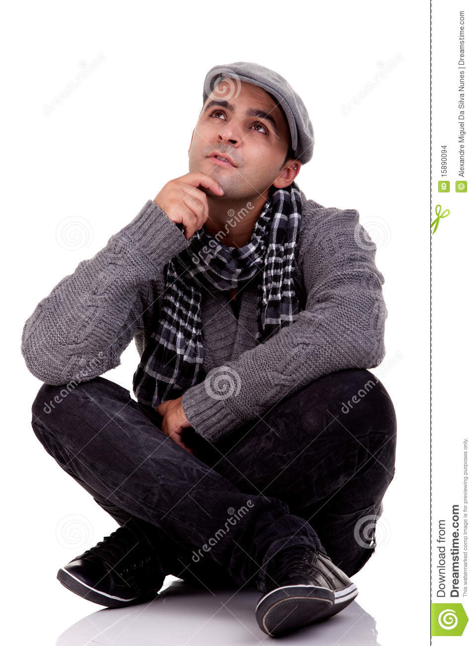 Young Man Sitting On The Floor Thinking Stock Photo