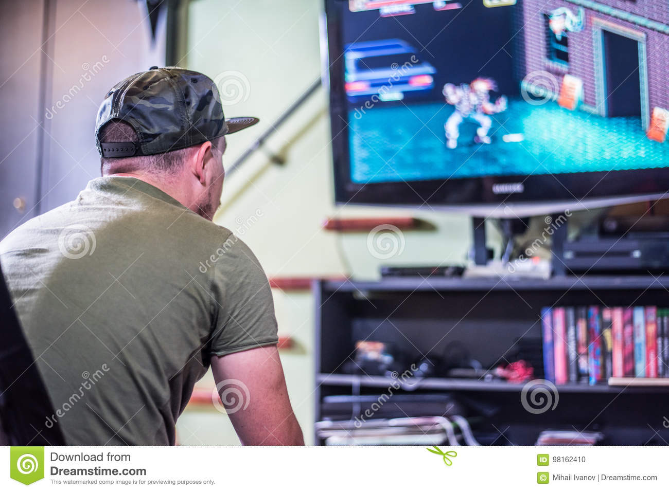 Retro Gamer In Front Of The TV Stock Photo - Image of being, home