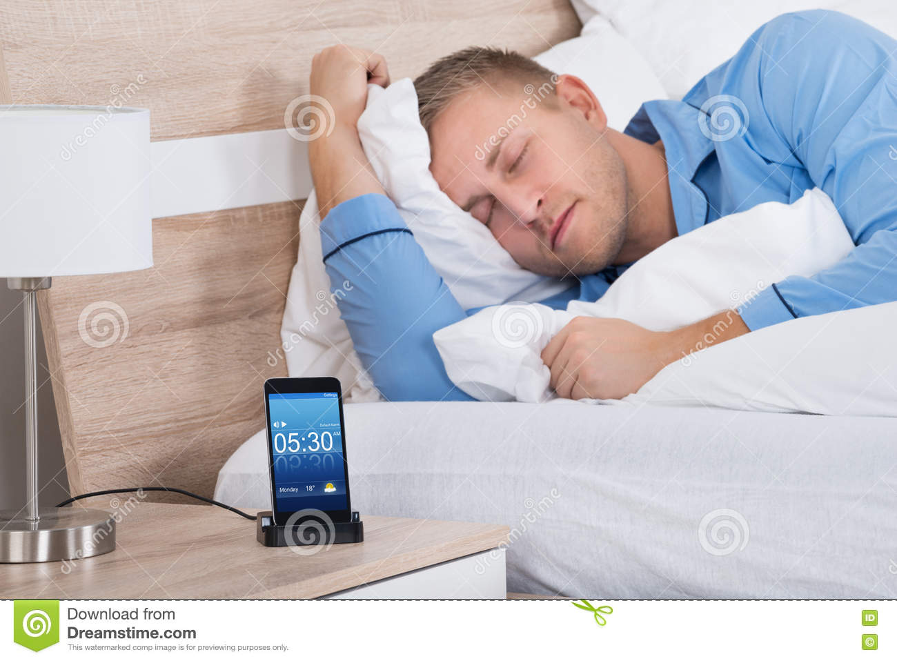 Young man sleeping on bed stock photo image 72446440 for Cell phone bed