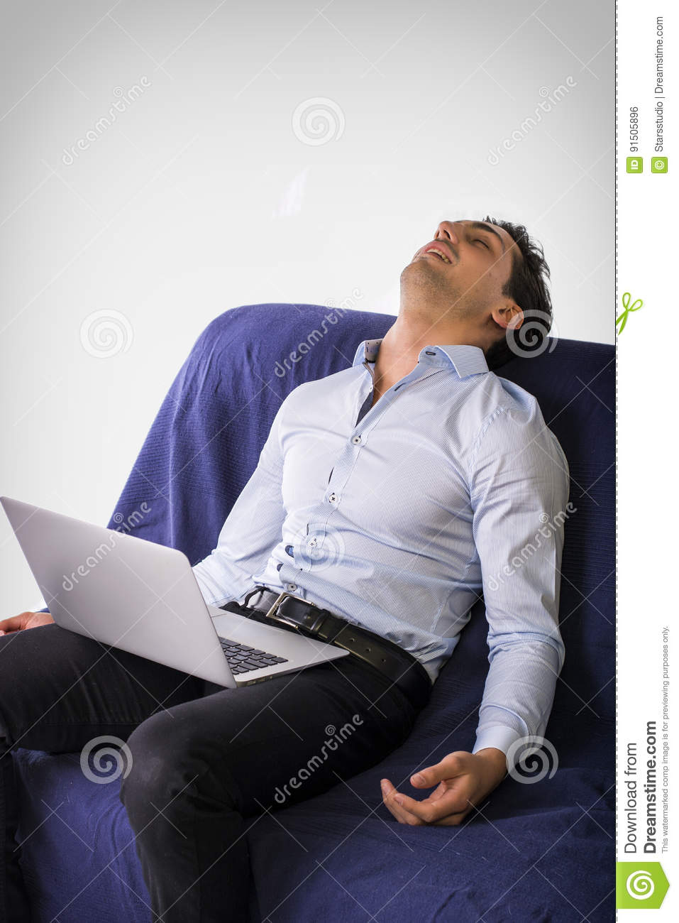 Amazing Young Man Sleeping With Computer On Couch Stock Photo Unemploymentrelief Wooden Chair Designs For Living Room Unemploymentrelieforg