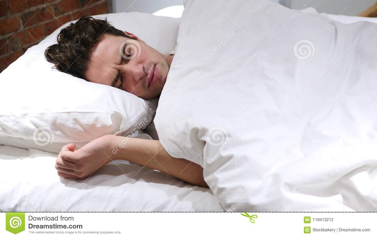 How Long Does Restoril (Temazepam) Stay in Your System?   Man Sleeping In Bed At Night