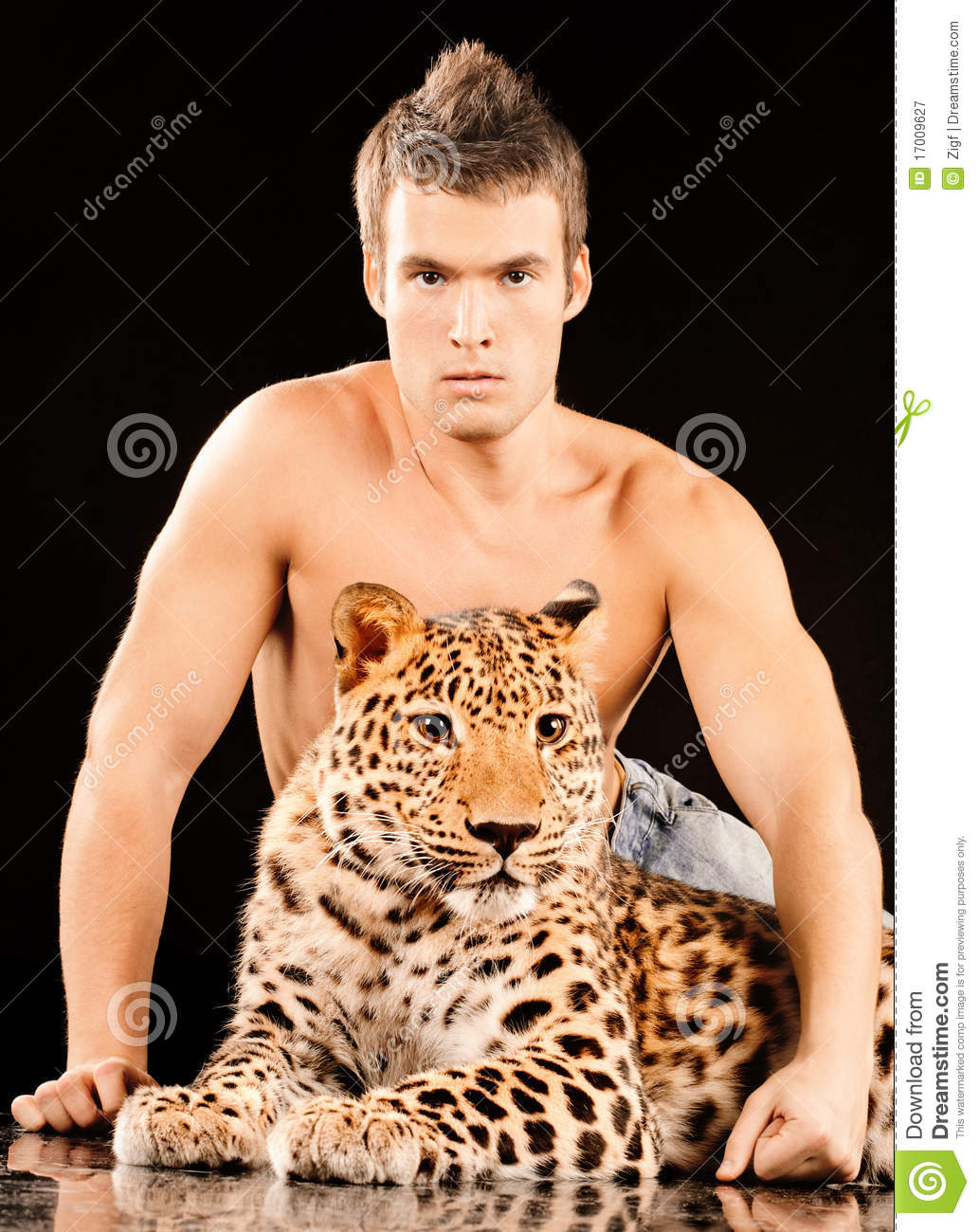 Young man and spotty leopard