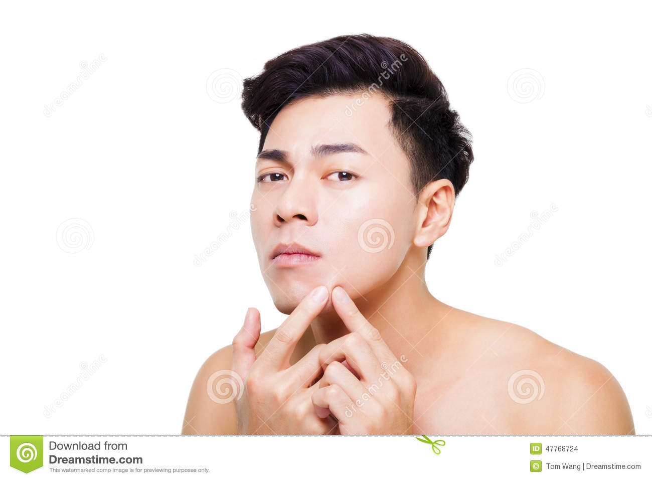 young man Squeezing pimple