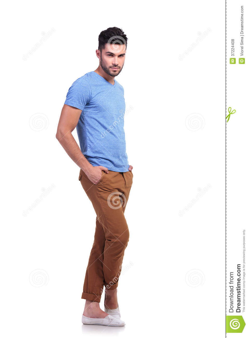 Young Man Standing With His Legs Crossed Stock Photo ...