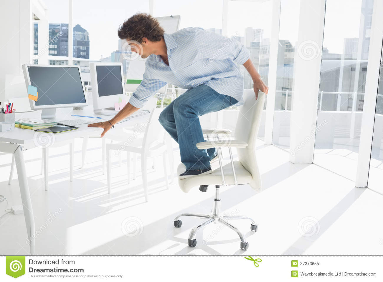 Awe Inspiring Young Man Standing Over Chair In Bright Office Stock Image Pabps2019 Chair Design Images Pabps2019Com