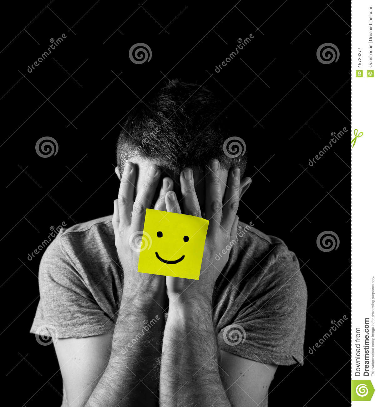 Young Man Suffering Depression And Stress Alone With Smiley Face