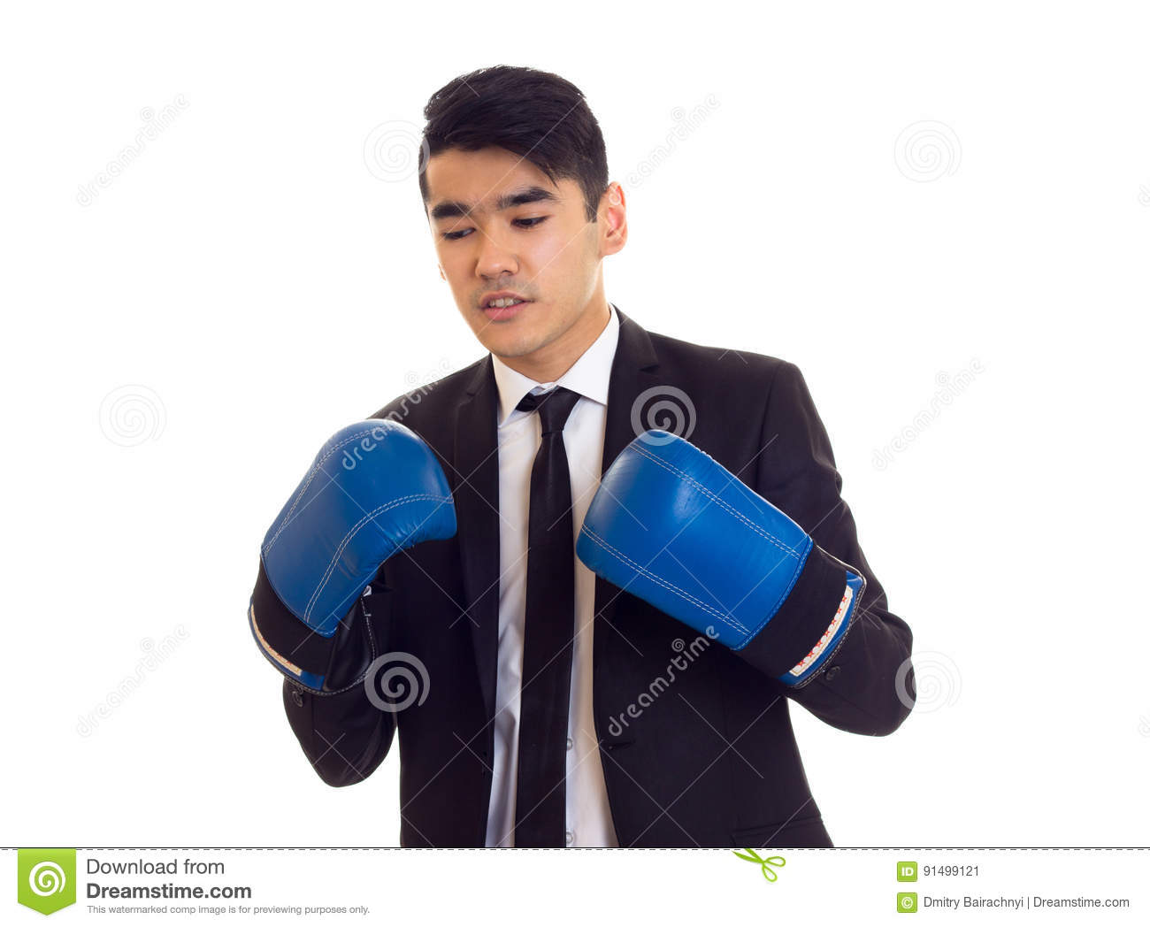 Pleasant young man with black hair in white shirt and black tuxedo with tie  and blue boxing gloves on white background 2056d8ba29