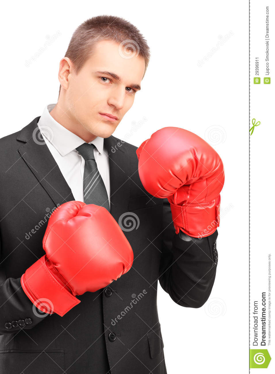 Young Man In Suit With Red Boxing Gloves Ready To Fight