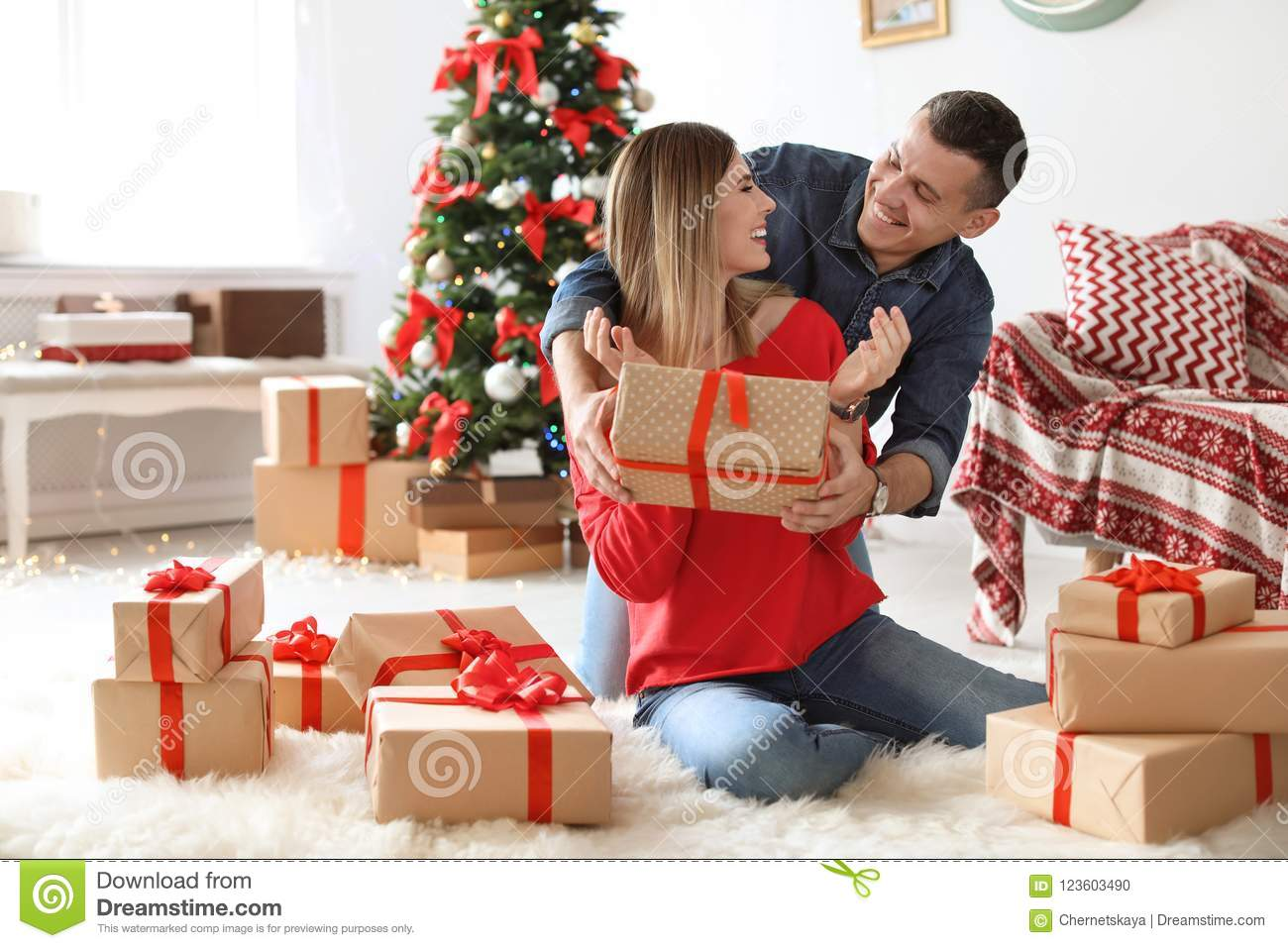 Young man surprising his girlfriend with Christmas gift  sc 1 st  Dreamstime.com & Young Man Surprising His Girlfriend With Christmas Gift Stock Photo ...