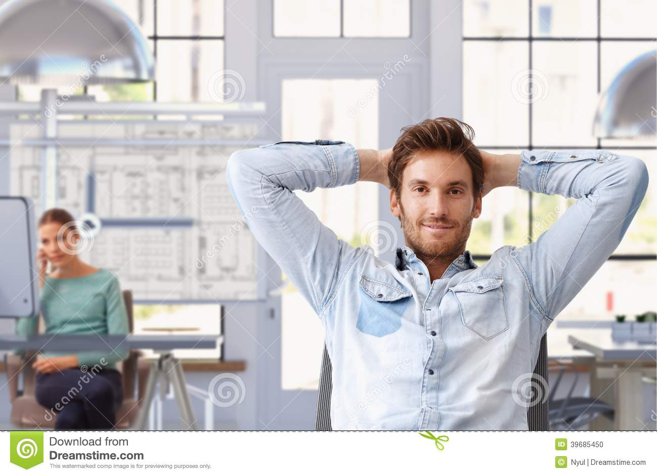 Young man taking break of work at architect office