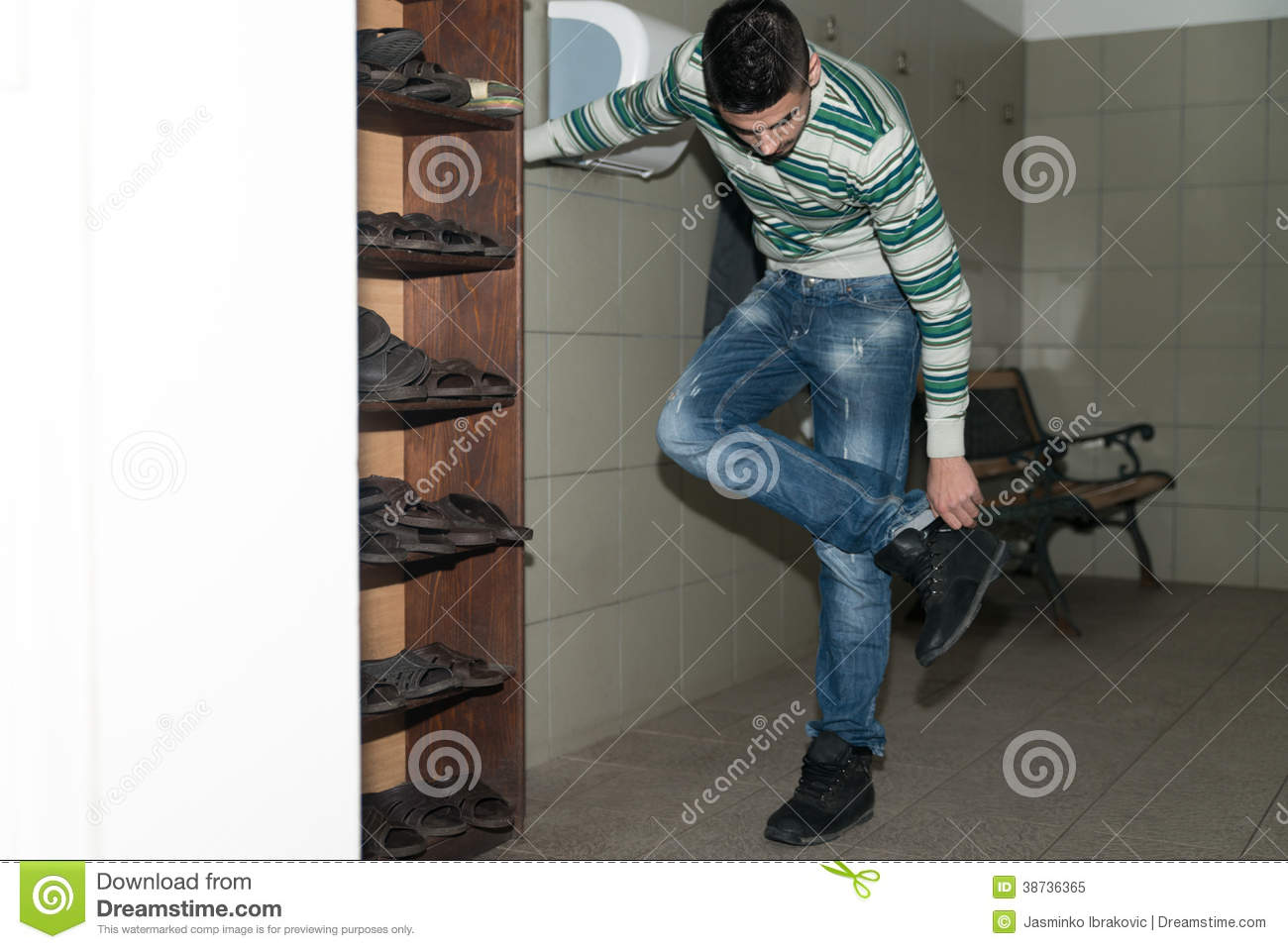 young man taking off his shoes royalty free stock photo - image