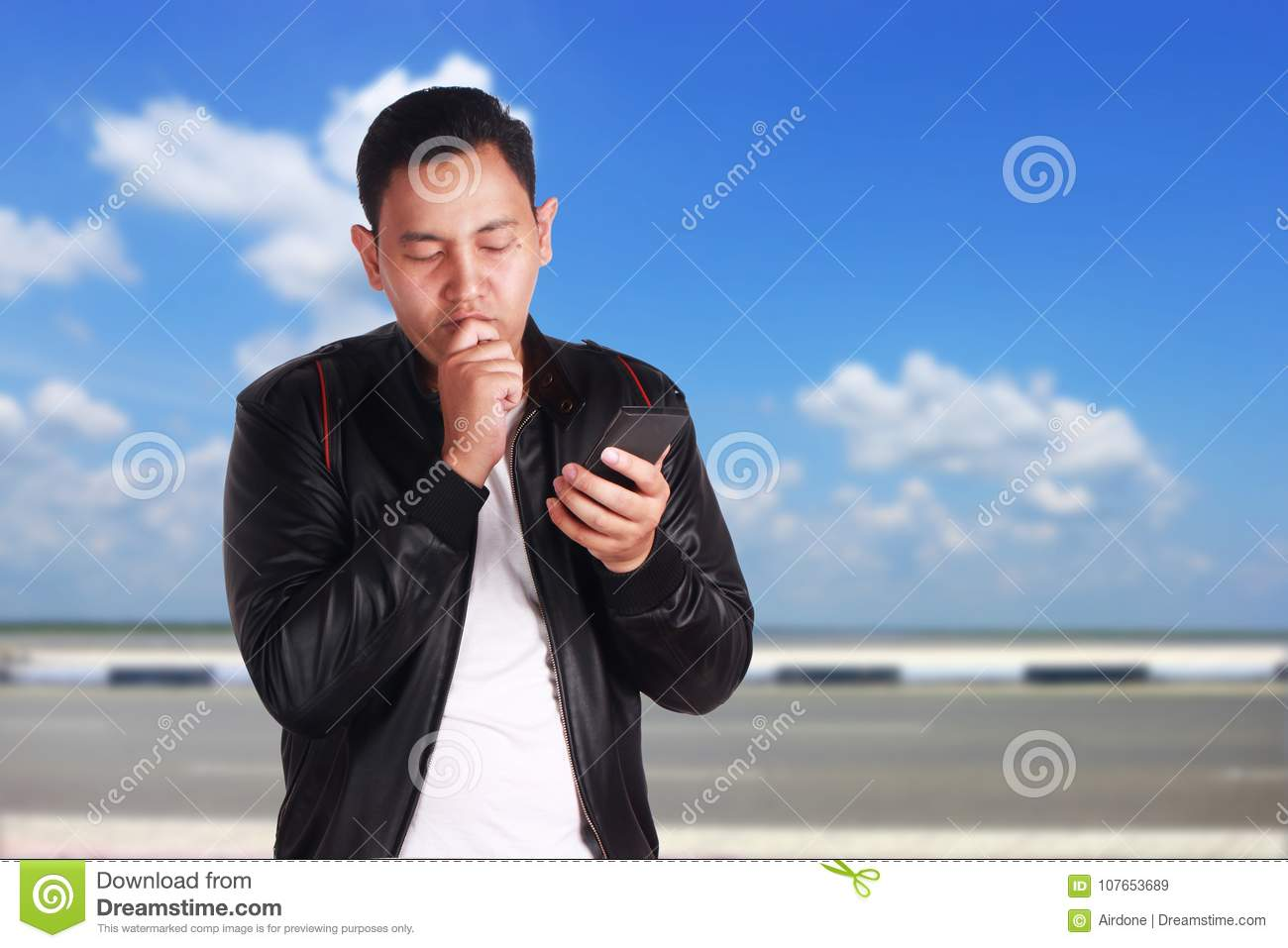 Young Man Texting Reading Chatting On His Phone Sad Gesture