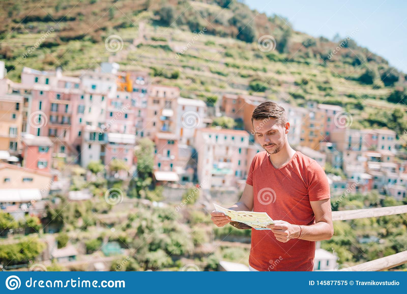 Young Man Tourist With Map Background Stunning Villag