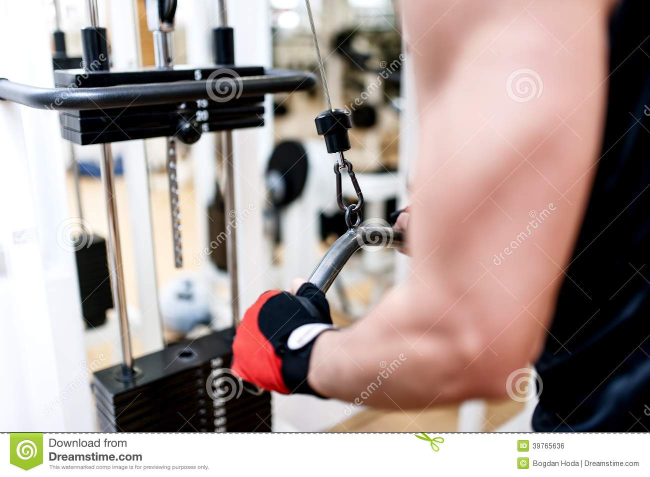 Young Man Training At Gym With Triceps Exercises Stock ...