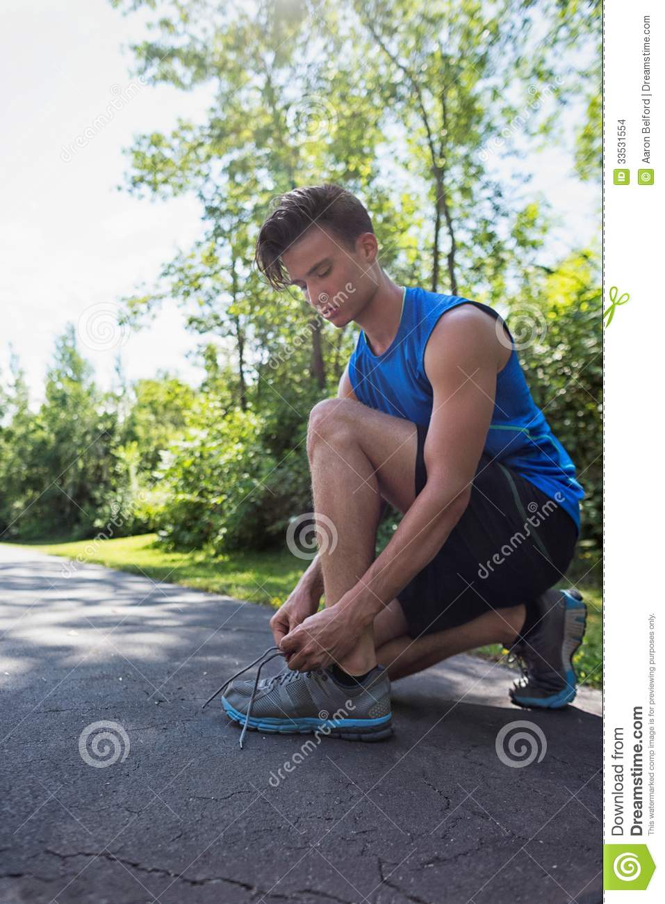 Sports Man Tying Shoelace Before Running Royalty-Free ...