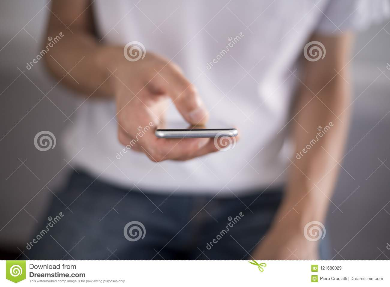 5636a1ae73dea Young man using apps on a touchscreen smartphone - Hands close-up, focus on  phone - Blue jeans and white t-shirt - Concept for using technology,  shopping ...