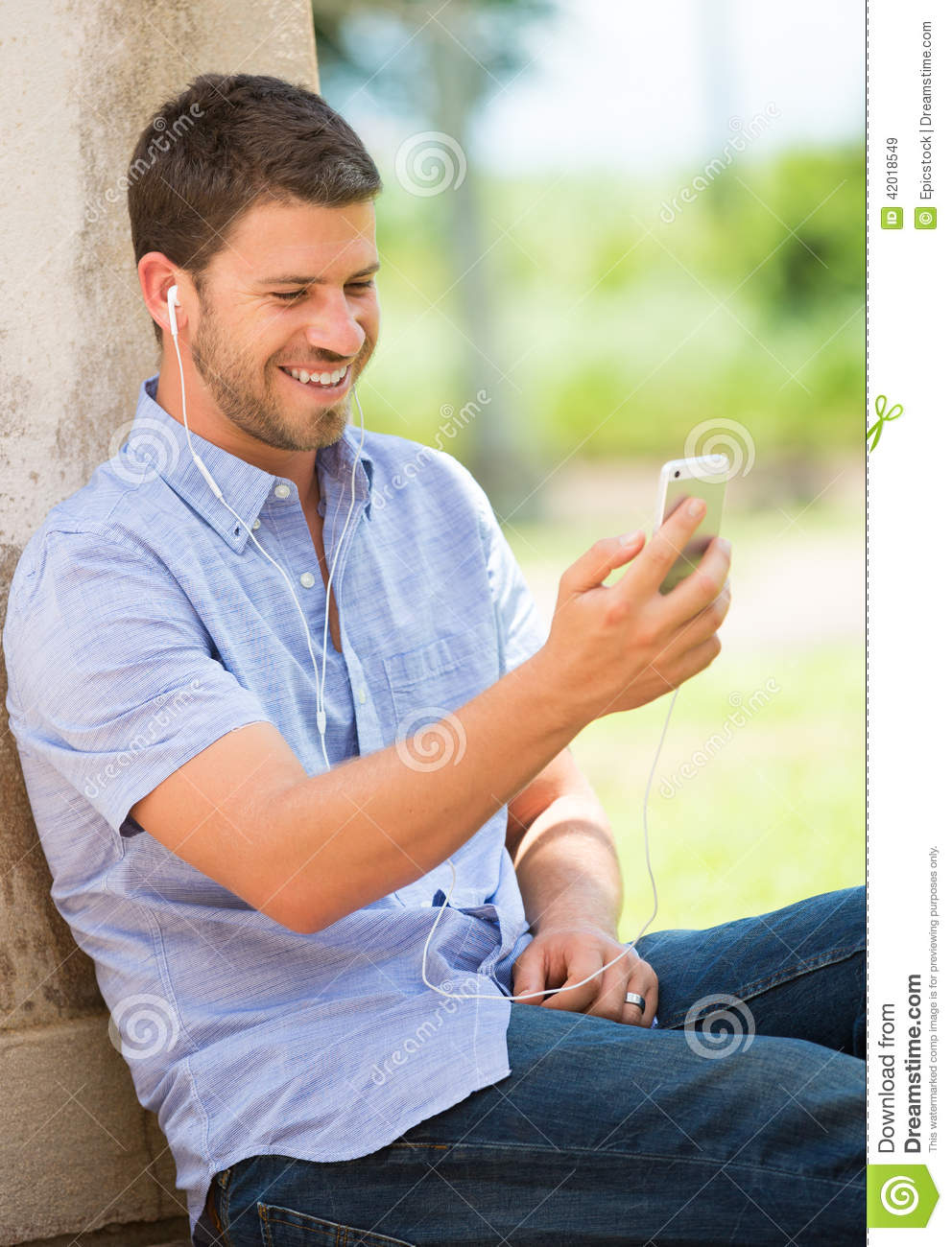 Man On Cell Phone : Young man using cell phone stock photo image