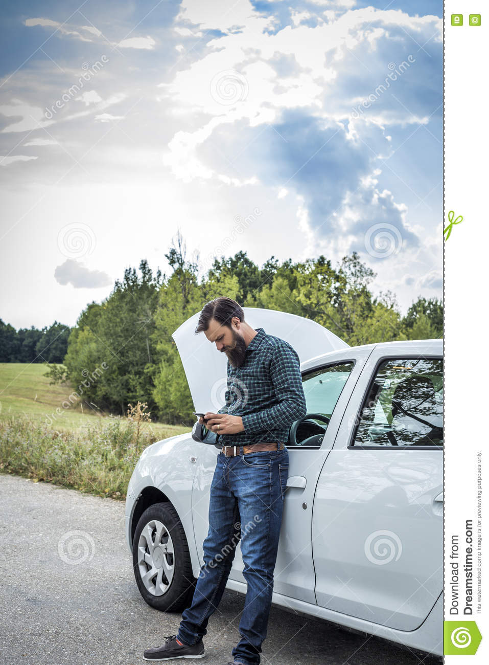 Broken Down Abandoned Stock Photos Broken Down Abandoned: Young Man Using His Cell Phone Next To A Broken Down Car