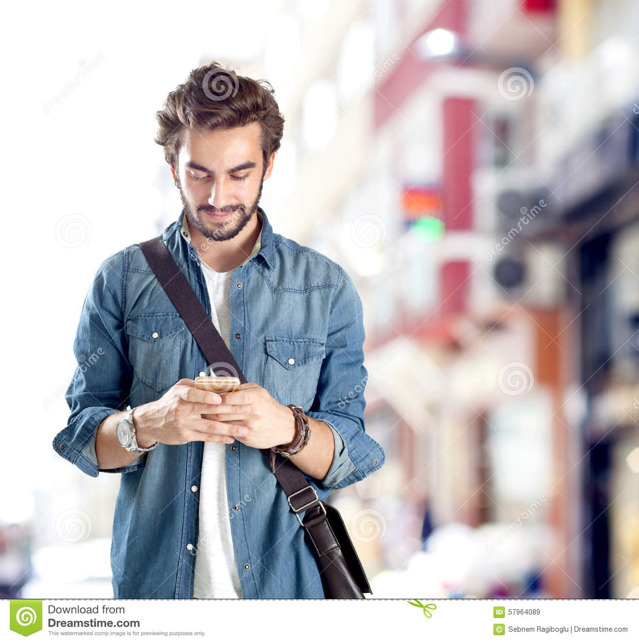 Man On Cell Phone : Young man using mobile phone royalty free stock