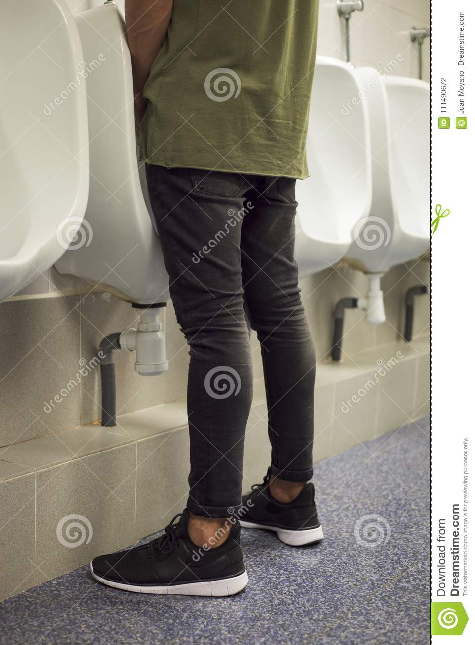 Download Young Man Using A Urinal In Public Washroom Stock Photo
