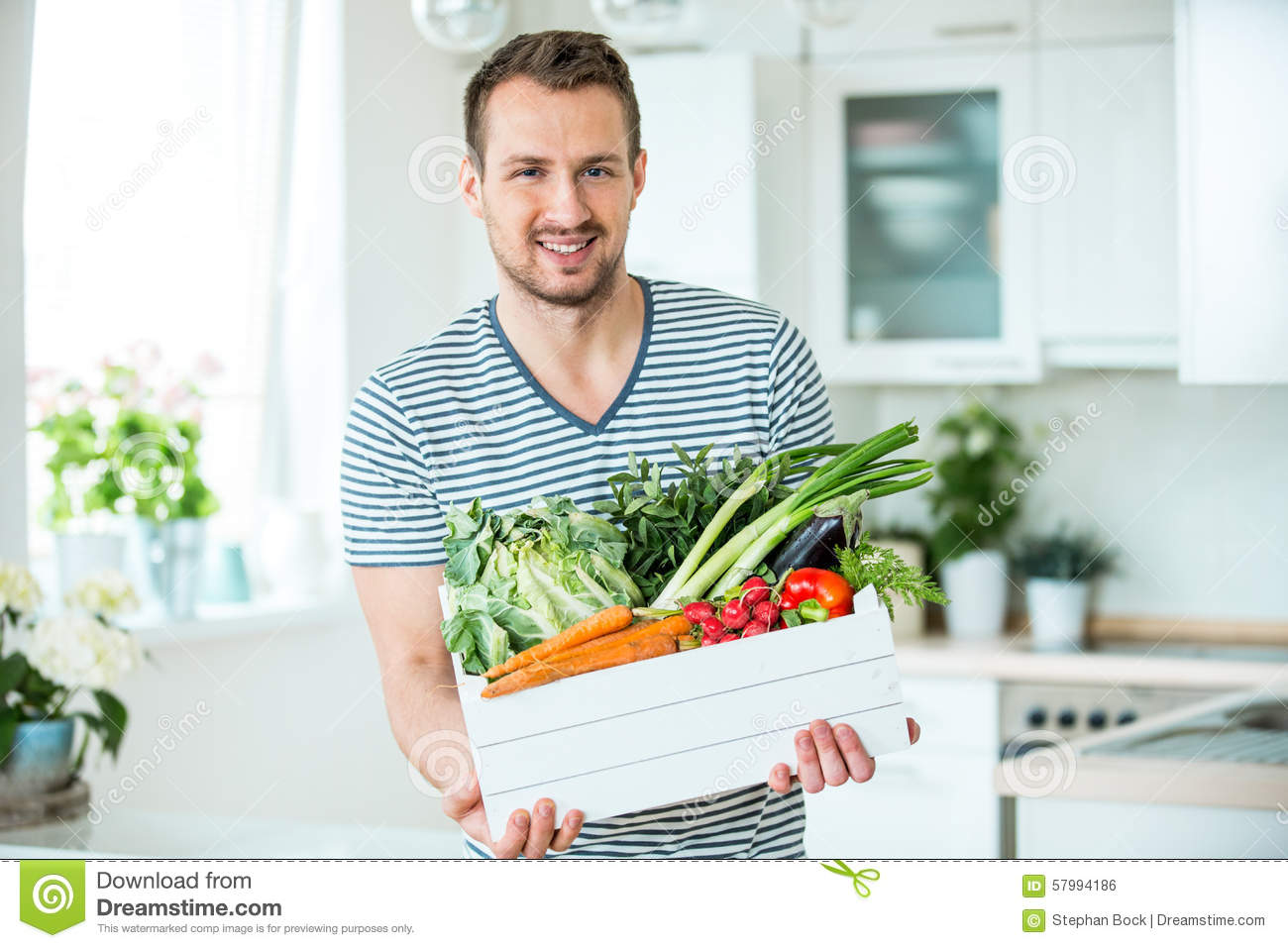 Young Man With Vegetable Box In Kitchen Stock Photo - Image of ...