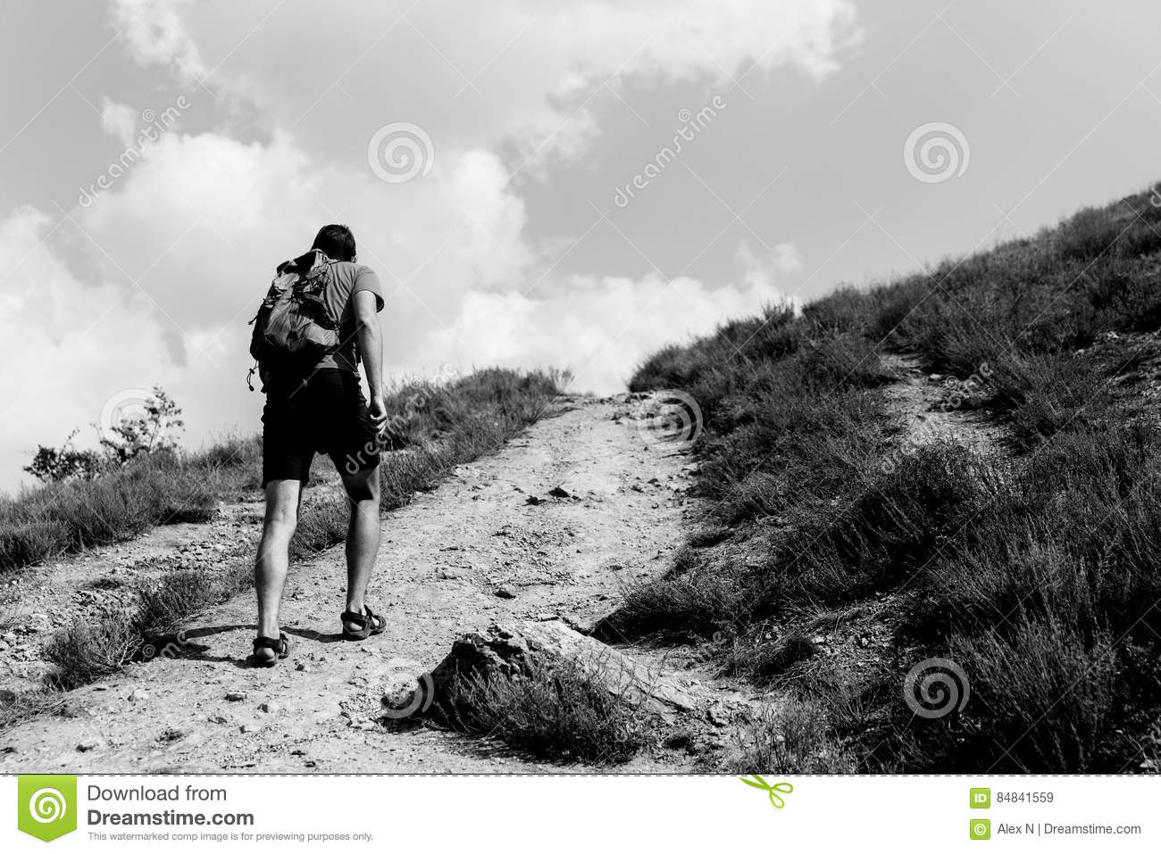 Young Man Walking Up Mountain