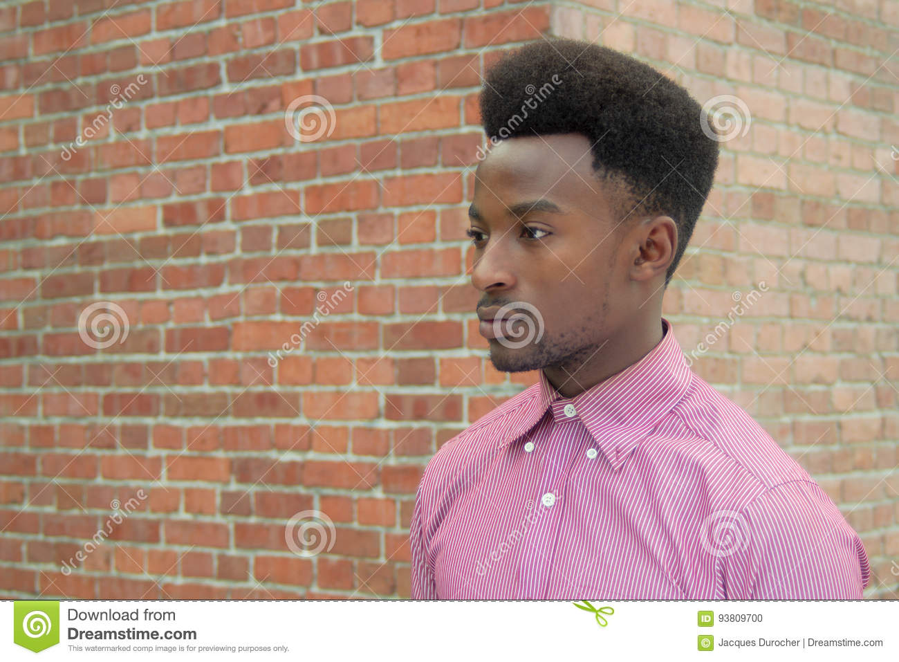 bd3b2b99 Man portrait young african guy urban portrait brick wall and pink shirt.  More similar stock images