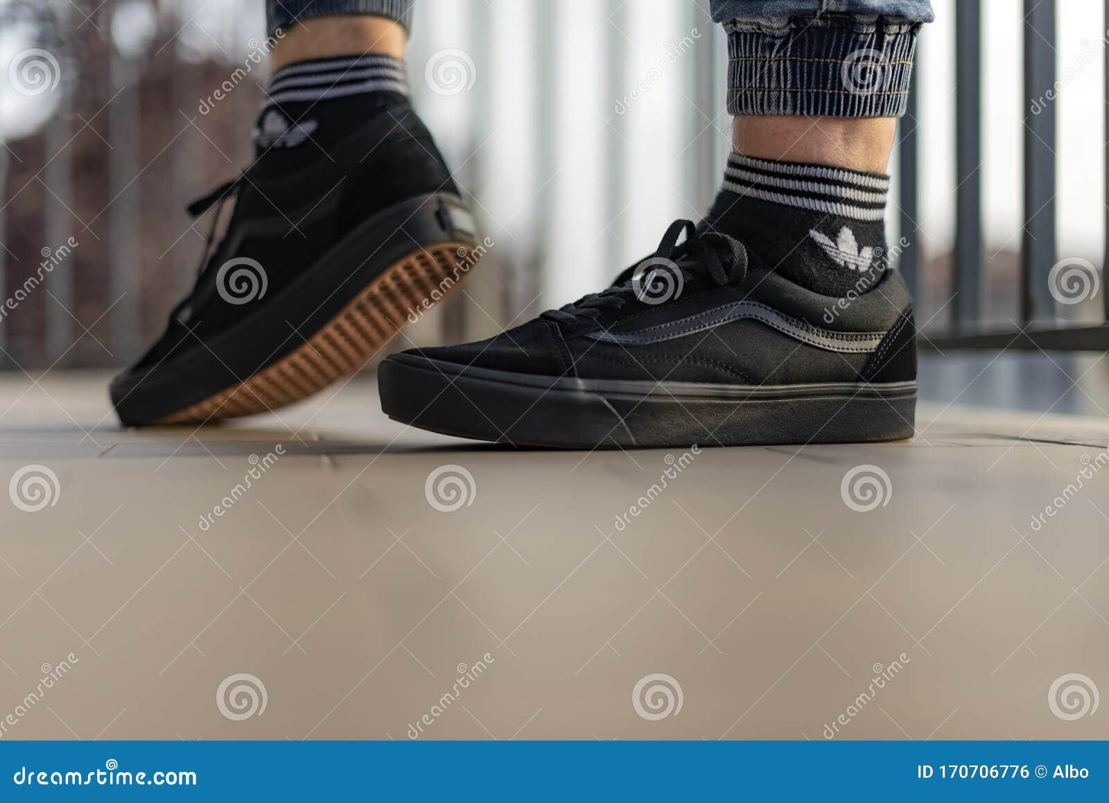 Young Man Wearing Vans Old Skool Shoes