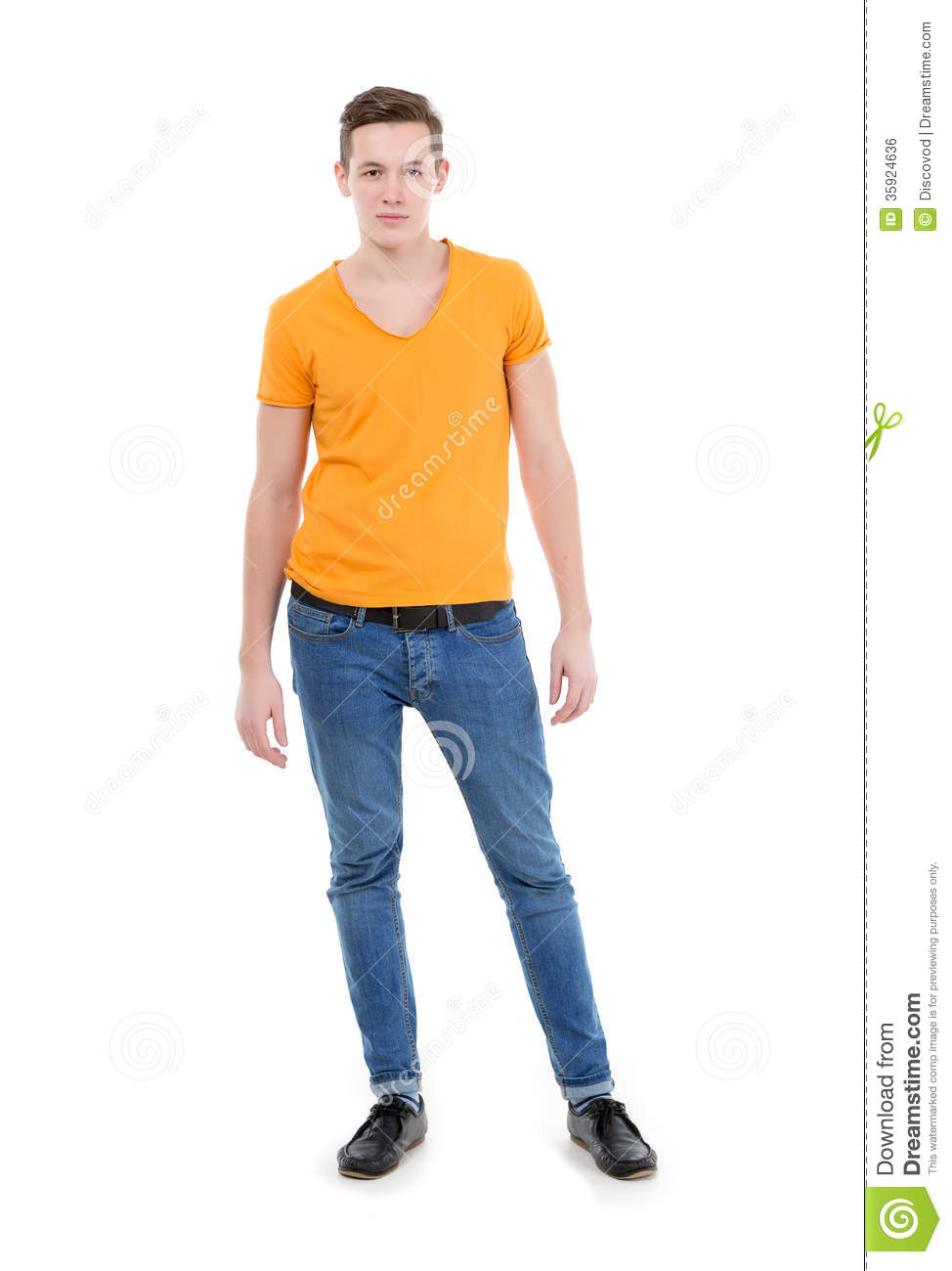 Young Man Wearing A Yellow T-shirt And Slim Jeans Royalty Free Stock Image - Image 35924636
