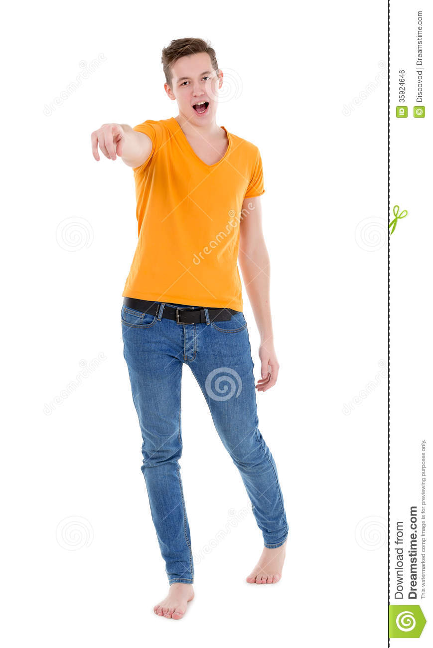 Young Man Wearing A Yellow T-shirt And Slim Jeans Stock ...