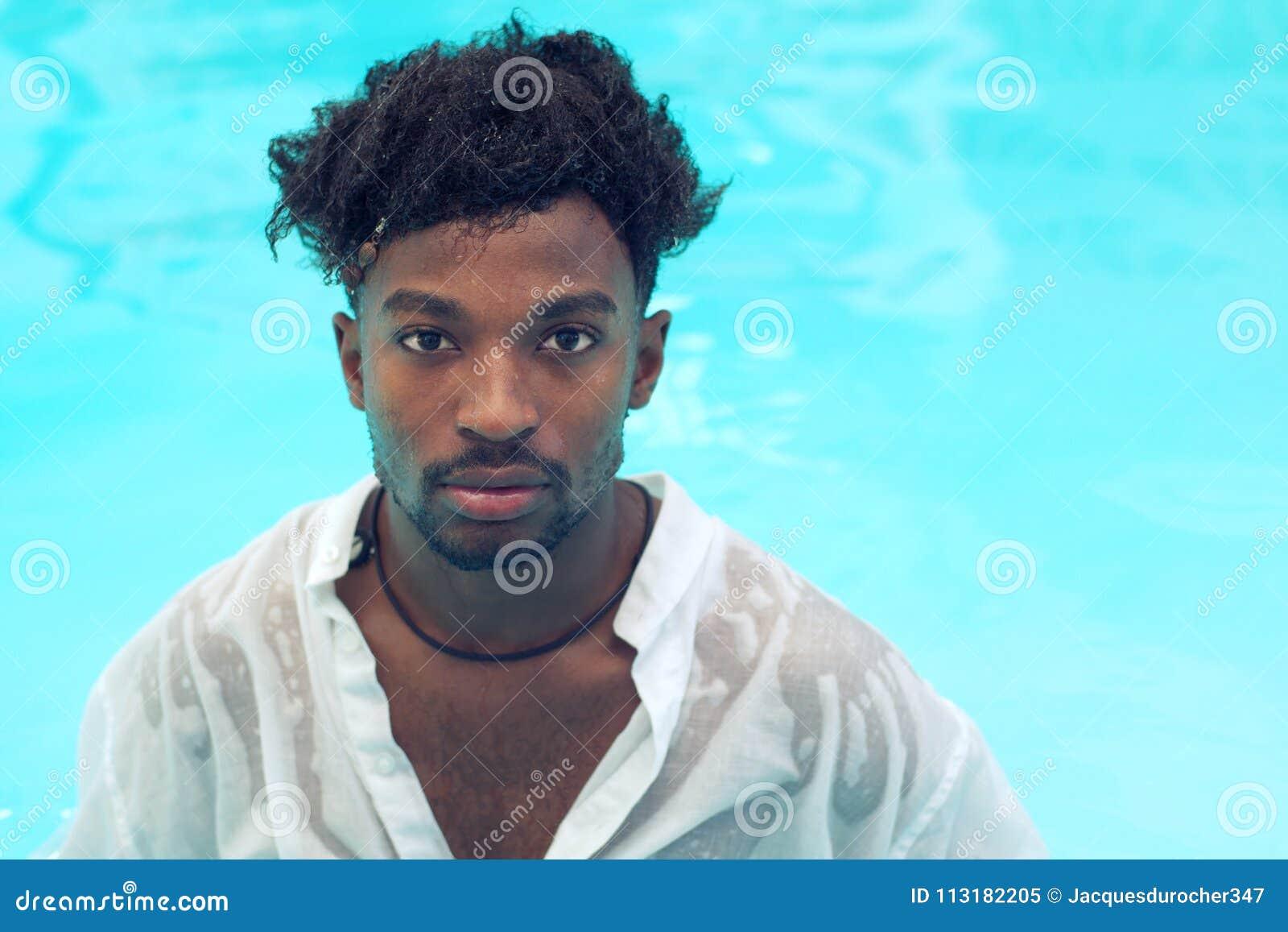 Young man wet shirt pool water swimming vacation
