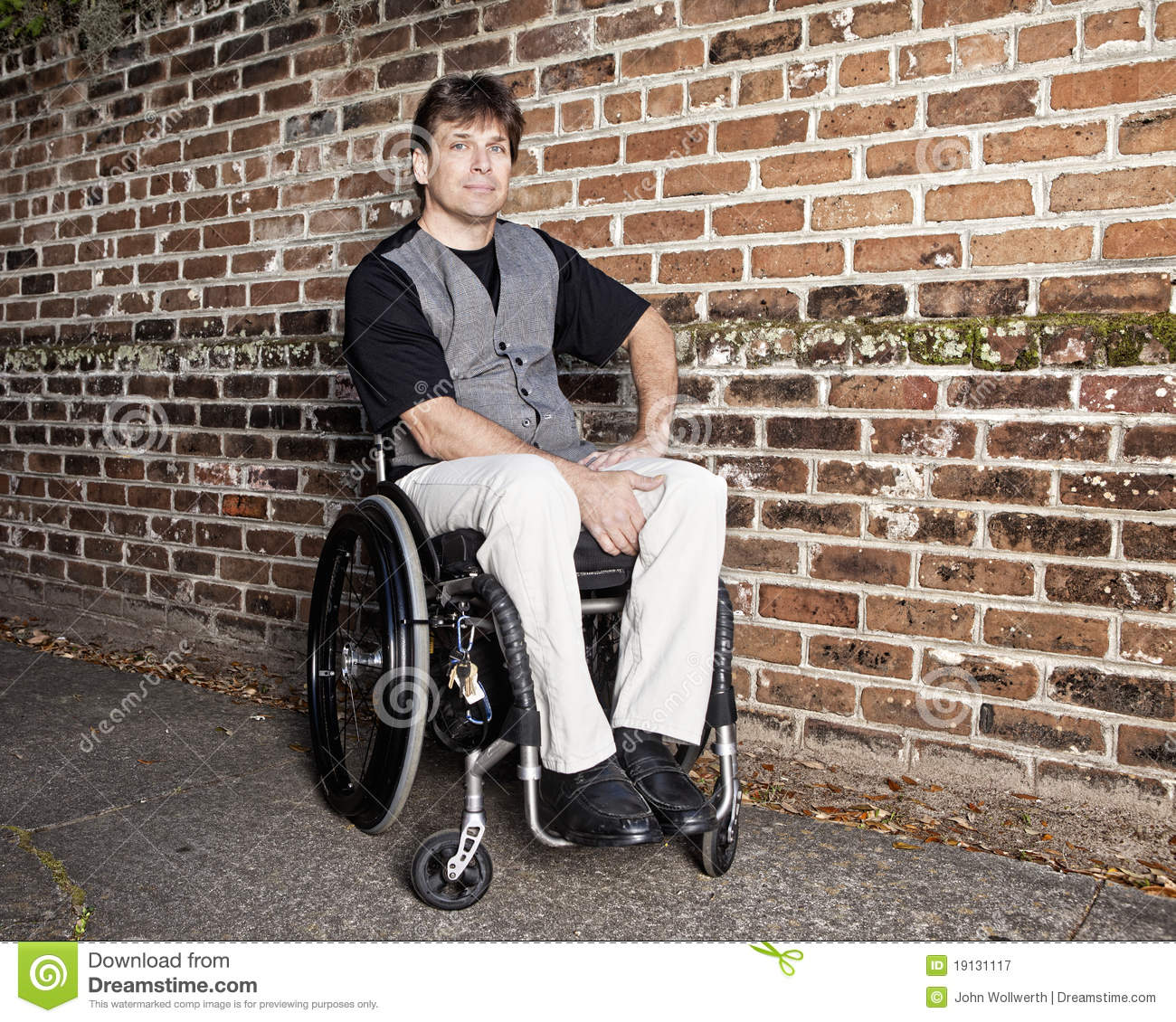 Young man in wheelchair royalty free stock photography image