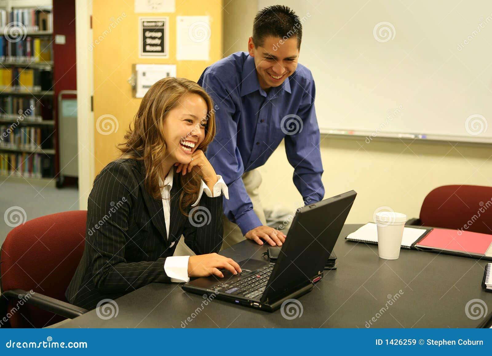 Young man and woman at Computer