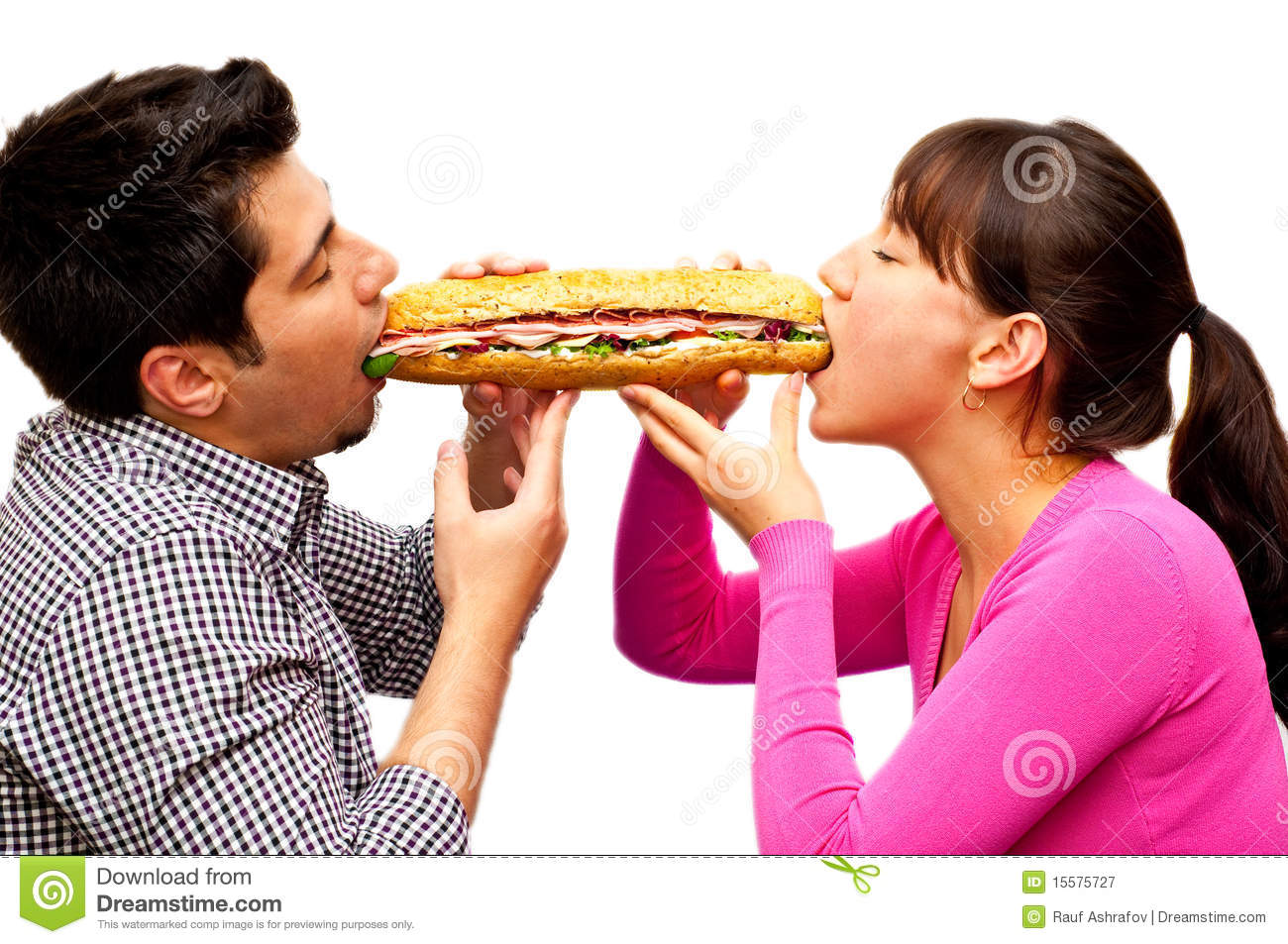 Young man and a woman eating sandwich from