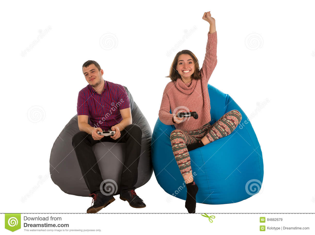 Young Man And Woman Are Enthusiastic About Playing Video Games W