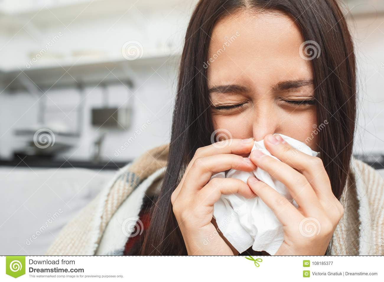 Young couple having evening at home girlfriend close-up sneezing
