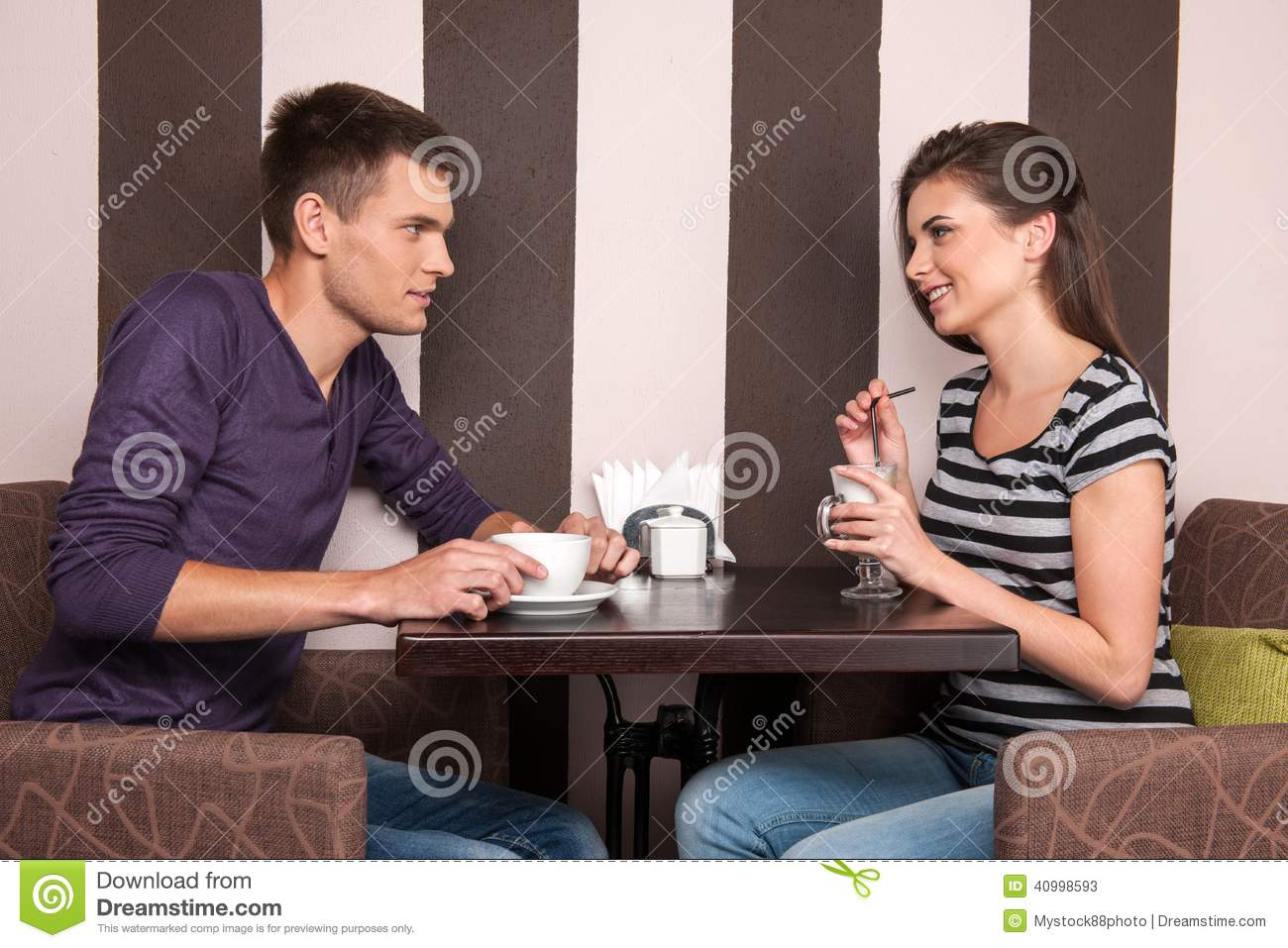 Guy and girl dating at irish coffee shop
