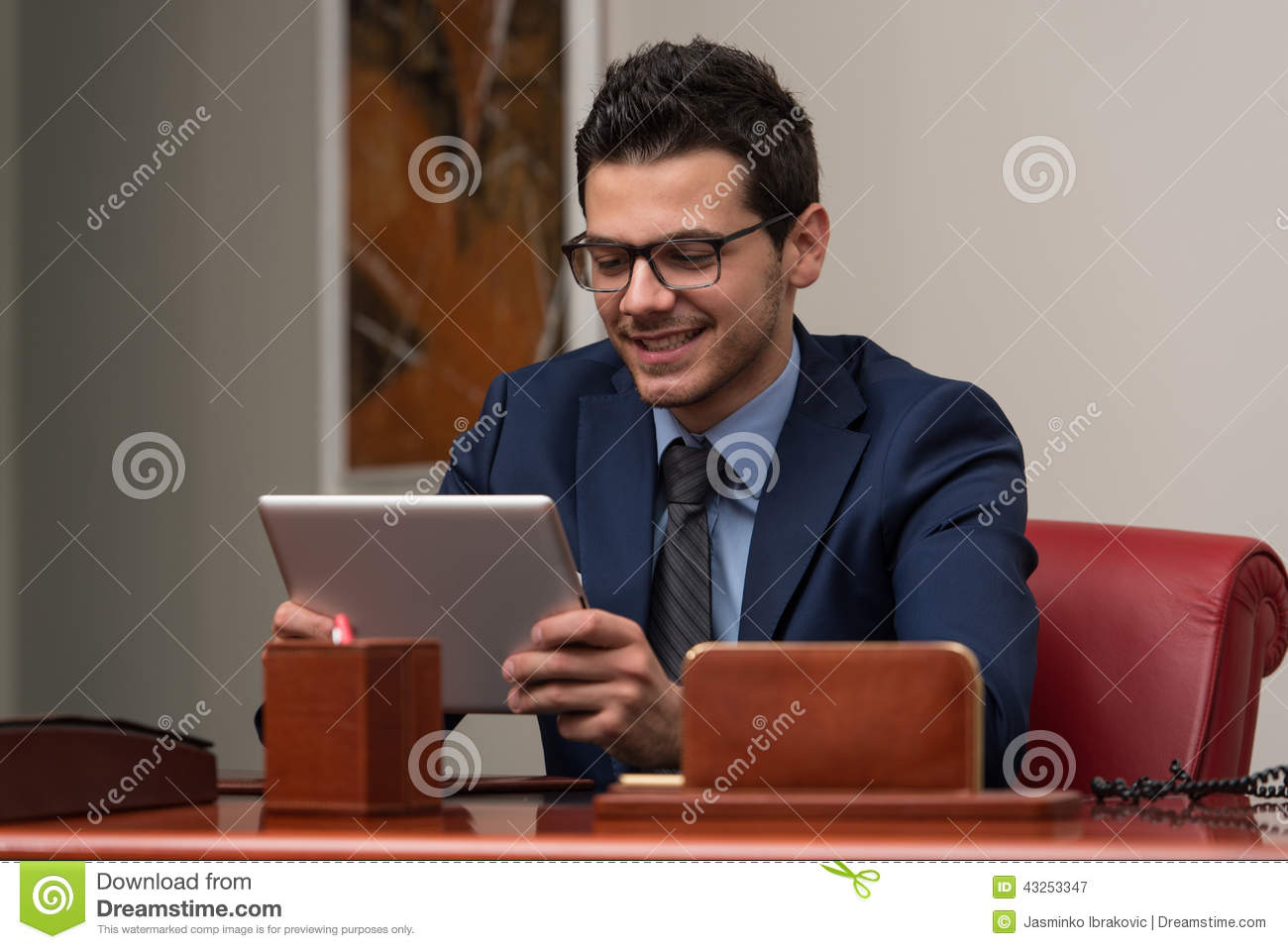 Young Man Working On Computer In Office