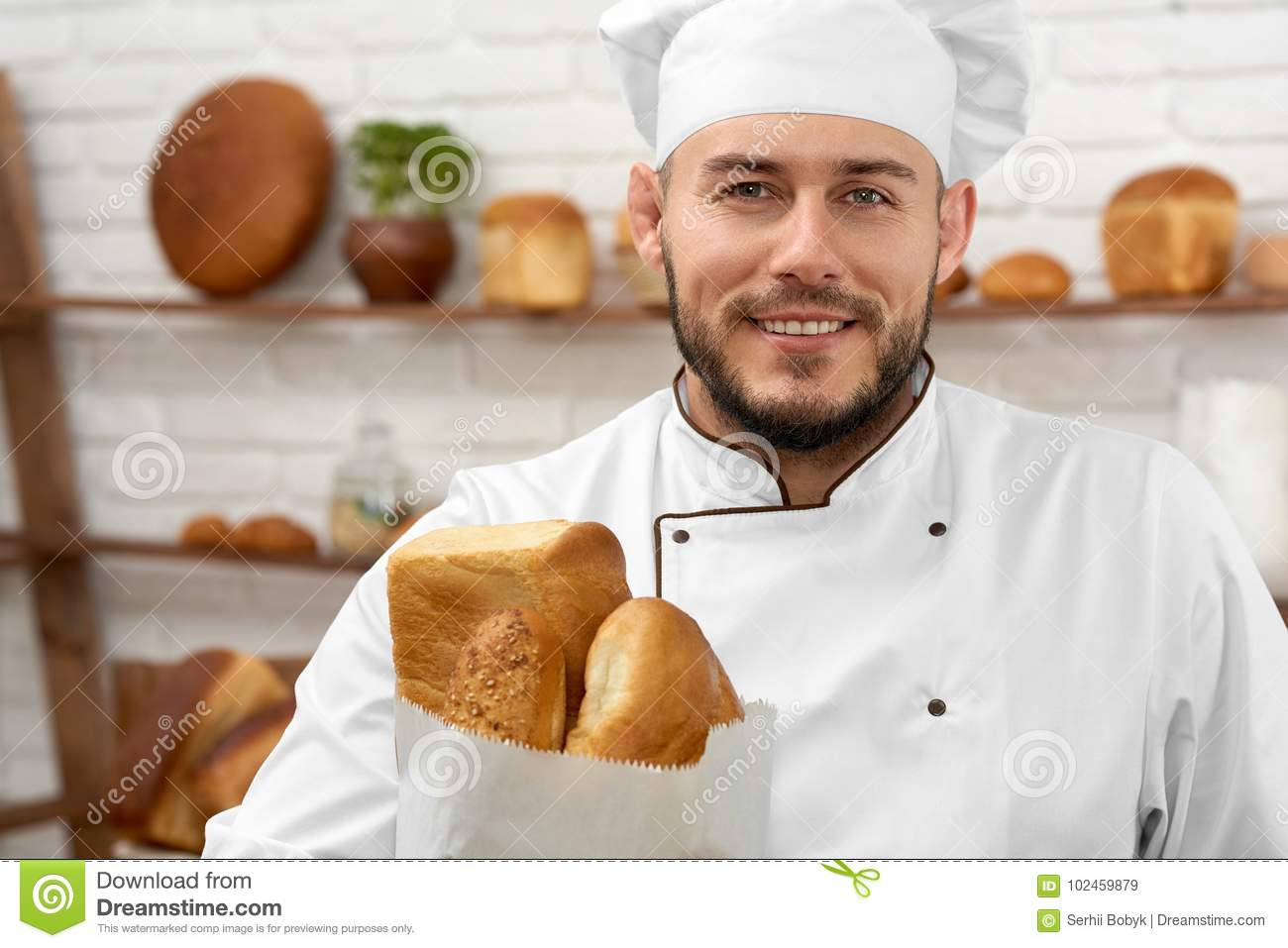 Young man working at his bakery